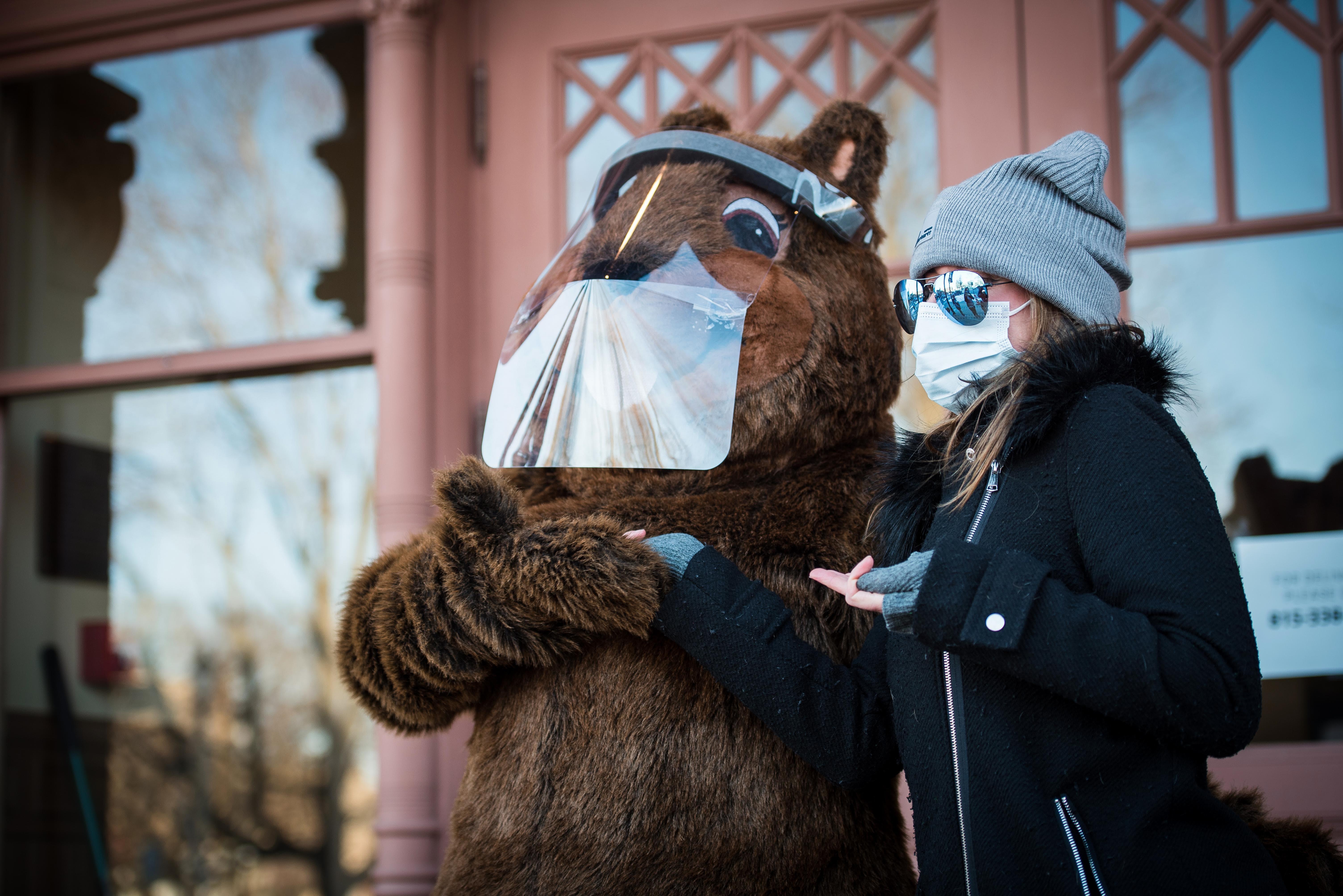 Slavin poses with Woodstock Willie in Dordan-provided face shield